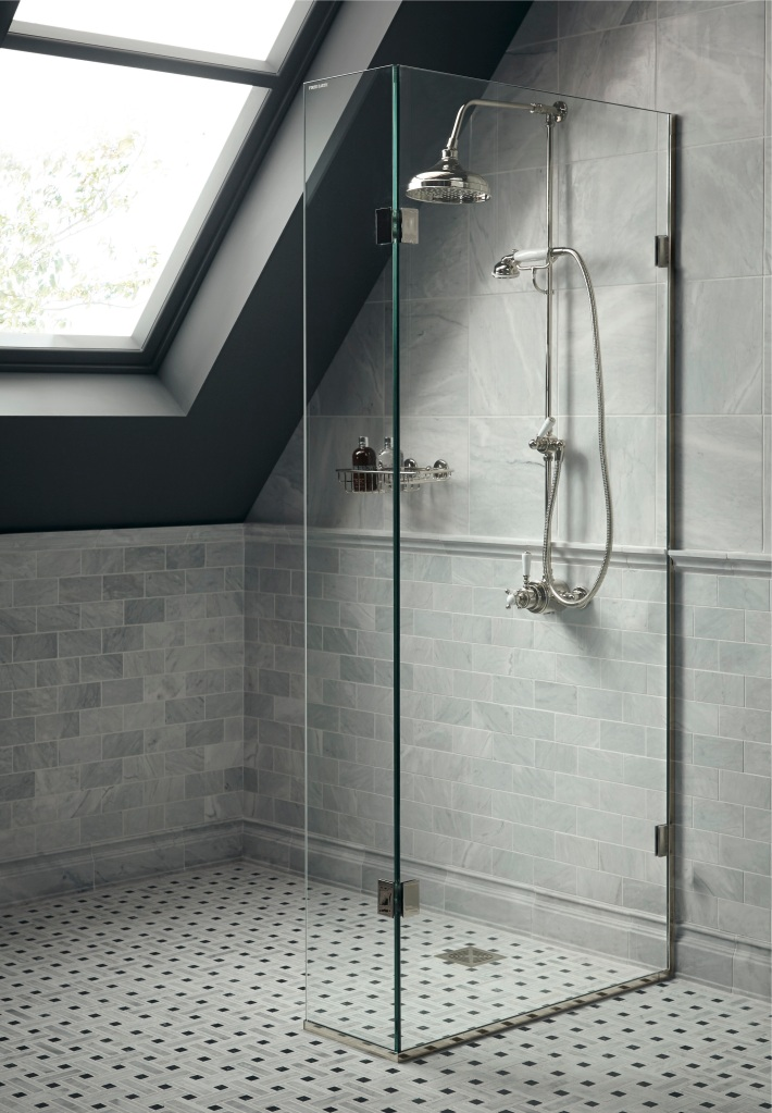 Frameless glass shower screen by Fired Earth.