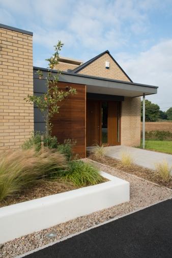 Wooden front door of new house