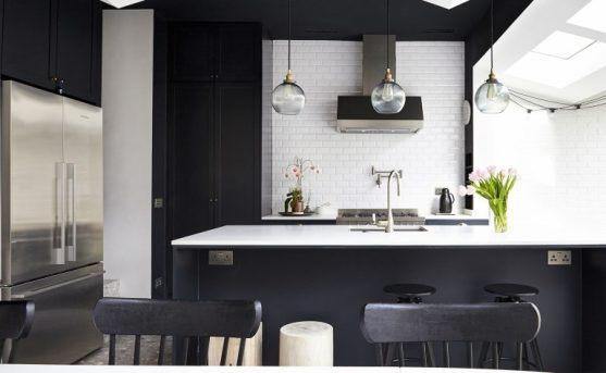 Glass pendant lights in black and white kitchen