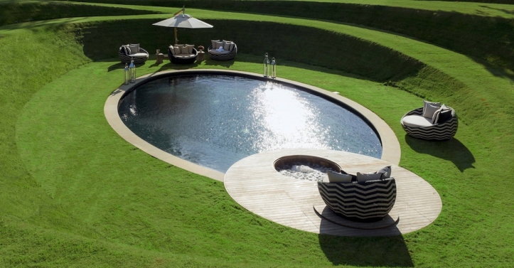 Curved swimming pool sunken lawn