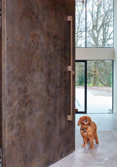 Oversized bronze door by Urban Front