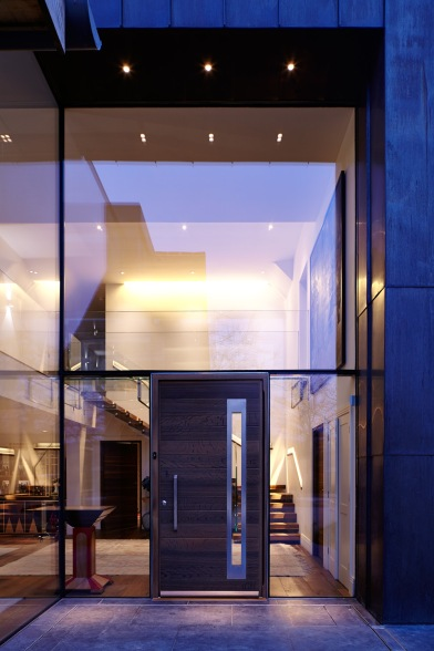 Wooden front door by Urban Front with oversized glazing